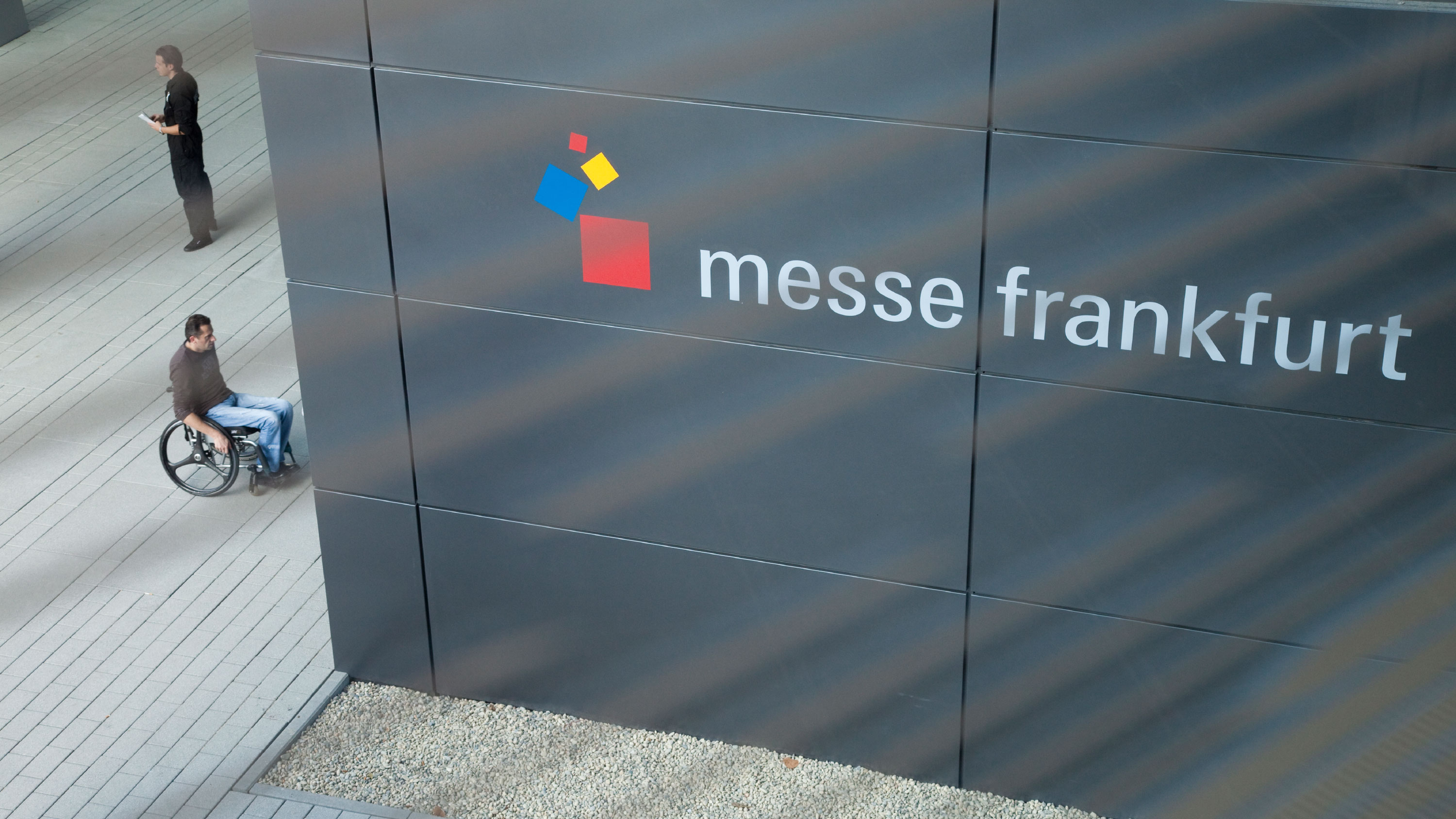 Man in a wheelchair at the entrance of Messe Frankfurt